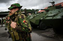 NATO troops ready for international deployment. The Portuguese army deployed a 140-men Pandur cavalry unit in Lithuania. The troops were deployed for a period of royalty free stock images