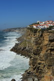 Portuguese Atlantic Cliff. The tiny white village of Azenhas Do Mar clings to the cliffs above the Atlantic Ocean a few kilometres north of Lisbon. Sintra Stock Photo