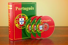 Portuguese book with flag of Portugal and CD discs on the wooden. Table. 3D Stock Photos