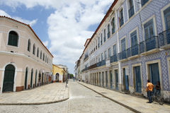 Portuguese Brazilian Colonial Architecture Rua Portugal Sao Luis Brazil. SAO LUIS, BRAZIL - OCTOBER 2, 2013: Man stands on the sidewalk of Rua Portugal, a street Stock Photo