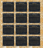 2017 Portuguese calendar. With each month on a black marble board on a brown stone wall Royalty Free Stock Photo