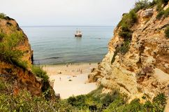 Portuguese caravel. Sailing near an Algarve beach Stock Images