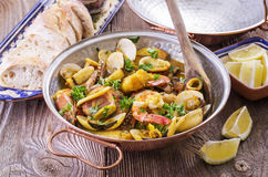 Portuguese Cataplana. With Seafood in a traditional pot royalty free stock photos