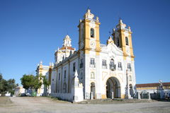 Portuguese church. An old decorative church with bell towers and an arched entrance in the Alentejo region of Portugal Stock Photos
