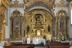 Portuguese church altar. With rich golden decoration Royalty Free Stock Images