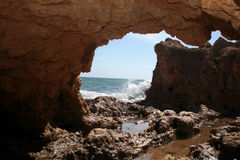 Portuguese Coast. A sandstone arch on the Portuguese coast Royalty Free Stock Photography