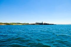 Water View - Fortress at Carcavelos Beach, Outskirts of Lisbon, Portuguese Flag stock photo
