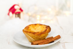 Portuguese cookie pastel de nata on plate Royalty Free Stock Images