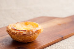 Portuguese custard tart. Portuguese egg custard tart, pastéis de nata, served on a wooden board. These delicious bakes are also popular in South East Asia Royalty Free Stock Photo