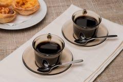 Portuguese Custard Tarts with Coffee Stock Photo
