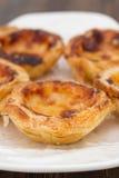 Portuguese dessert pasteis de nata on white dish Stock Photos