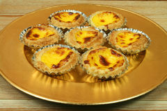 Portuguese egg tarts on golden plate Royalty Free Stock Image