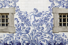 Portuguese facade with windows. Detail of a facade decorated with angels tile Royalty Free Stock Images