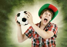 Portuguese fan loudly shouts on the Brazilian colors background Royalty Free Stock Images