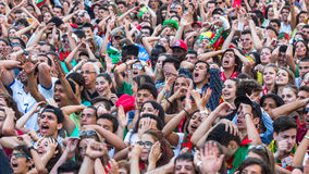 Portuguese fans during translation of the football match Portugal - France final of the European championship 2016 Royalty Free Stock Image