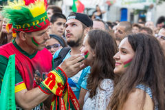Portuguese fans during translation of the football match Portugal - France final of the European championship 2016 Royalty Free Stock Photos