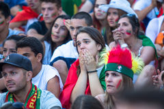 Portuguese fans during video translation of the football match Portugal - France final of the European championship 2016 Royalty Free Stock Image