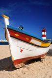 Portuguese Fishing Boat. Traditional brightly coloured Portuguese fishing boat royalty free stock photo