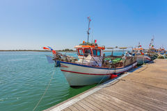 Portuguese fishing boat on the pier. Stock Photos
