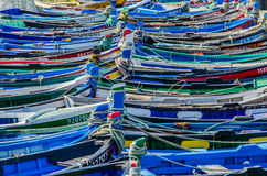 Portuguese Fishing Boats. Composition of ligned up colorful and wooden fishing boats in Setubal, Portugal Stock Photos