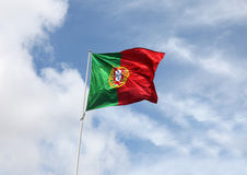 Portuguese Flag flying in the wind Stock Photos
