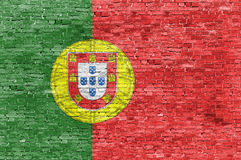 Portuguese flag over brick wall. Portuguese flag over old brick wall Royalty Free Stock Photography