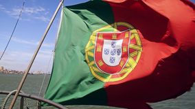 Portuguese flag on a ship on sky background stock footage