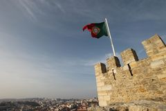 Waving Portuguese Flag on top of Castle stock photo