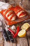 Portuguese food: chicken piri piri close-up. Vertical Royalty Free Stock Photography