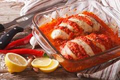 Portuguese food: spicy chicken piri piri close up in baking dish Stock Photos