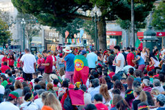Portuguese football fans watching Euro 2016 Final. UEFA Euro 2016 Final between France and Portugal with thousands of Portuguese fans watching the match on a big royalty free stock photo