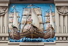 Portuguese Galleons Engraving Santos Brazil. The engraving of three Portuguese Galleons sailing ships (Naus) on a wall of a historical building in downtown Stock Image