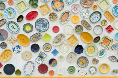 Portuguese handcrafted, colorful decorated plates on the wall Stock Images