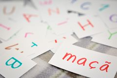 Portuguese; Learning the New Word with the Alphabet Cards; Writi. Ng APPLE Stock Image