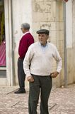 Portuguese man with hat stands in the historic town center of Tomar, Portugal Stock Images