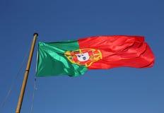 Portuguese National flag against blue sky. Stock Images