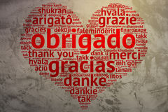 Portuguese: Obrigado, Heart shaped word cloud Thanks, Grunge Bac Royalty Free Stock Images