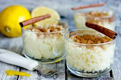 Portuguese rice pudding arroz doce. With cinnamon and lemon stock images