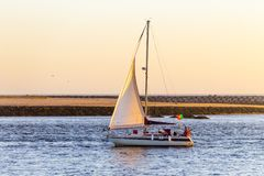 Portuguese Sailboat Passes by at Dusk royalty free stock photography