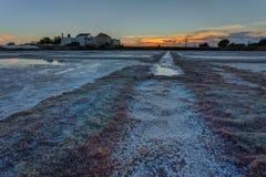 Portuguese sea salt lakes. Sunset in evening. Stock Photos