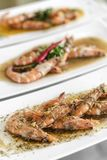 Portuguese seafood mixed traditional prawn tapas dishes on restaurant table stock images