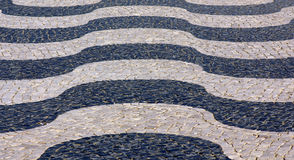 Portuguese sidewalk. Detail of a typical portuguese sidewalk Royalty Free Stock Photos