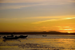 Portuguese sunset. An amazing sunset, with some typical portuguese boats Royalty Free Stock Photos