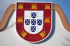 Portuguese shield. The portuguese symbol represented on tiles, five Quinas (blue shields) and seven castles, which have been present in every portuguese national royalty free stock photos