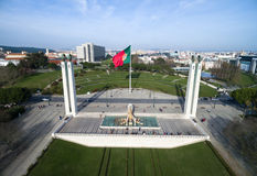 Portuguese Waving Flag on top of the Eduardo VII Park in Lisbon, Portugal Royalty Free Stock Images