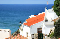 Portuguese white house upon rock, Portugal Royalty Free Stock Photo