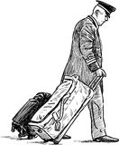Portvakt med resväskorna Fotografering för Bildbyråer