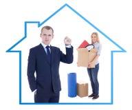 Poruszający dnia pojęcie - biznesmena agent nieruchomości daje kluczowi Fotografia Royalty Free