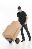 Poruszający dom. Pełna długość młody deliveryman z ręki ciężarówką Obrazy Royalty Free