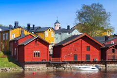 Porvoo, Finland. Old red wooden houses. Porvoo town, Finland. Old red wooden houses on the river coast in sunny day Royalty Free Stock Photo